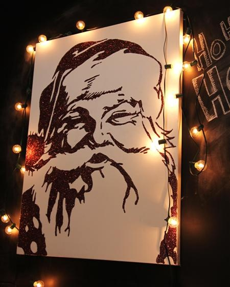 Santa Clause made on off white canvas with fine red glitter! I should so do this!