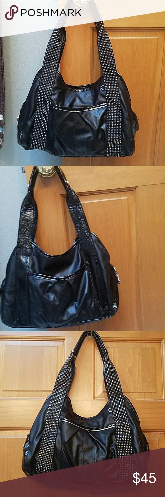 Kathy Van Zeeland black purse with silver accents. Cute black purse with silver embellishments. In great condition. Offers welcome. Kathy Van Zeeland Bags Shoulder Bags