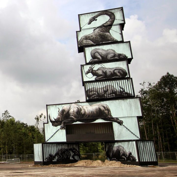 Street artist ROA's latest work painted giant murals on stack shipped containers to bring attention to the plight of caged animals around the world
