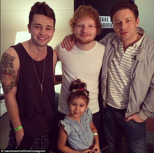Famous friends! Ed Sheeran posed for a photo with Jamie Oliver (right), Reece Mastin (left) and Mahalia Barnes' daughter Ruby backstage at his Sydney concert on Thursday