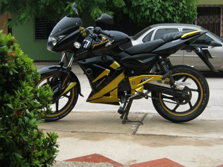 Love the color...yellow and black bike on the road....
