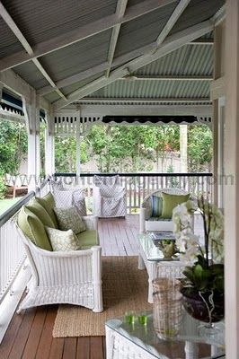 Back Porch - Love the white wicker furniture. Also, maybe we should put down some flooring/patio decking on the concrete patio pad. It would add a lot to the feel of the space.