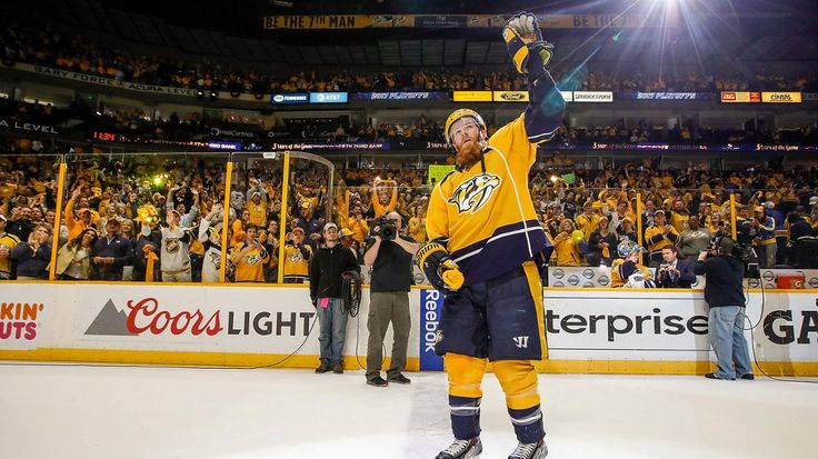 Nashville, TN - May 2: Ryan Ellis #4 of the Nashville Predators waves to fans as First Star of the Game after a 2-1 win against the St. Louis Blues in Game Four of the Western Conference Second Round during the 2017 NHL Stanley Cup Playoffs at Bridgestone Arena on May 2, 2017 in Nashville, Tennessee.