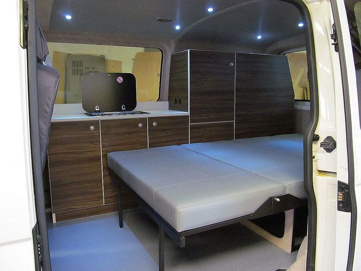 Vw t5 camper conversion rock 39 n 39 roll bed vw t5 interior for Fixed price house build