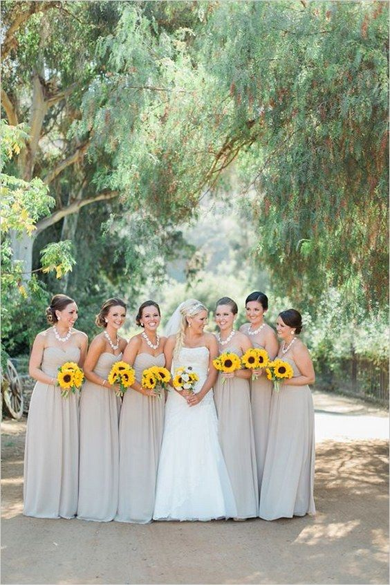 tan bridesmaids dresses with sunflowers / http://www.himisspuff.com/country-sunflower-wedding-ideas/3/