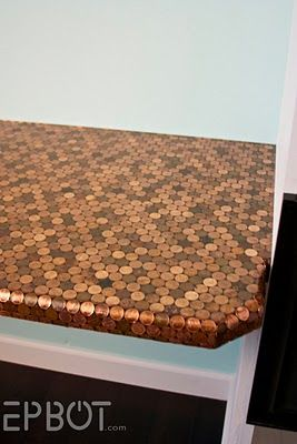 Table top mosaic from PENNIES! (I'd love to do this on the backsplash in our kitchen. I wonder if Lovey would go for it... - Sam)