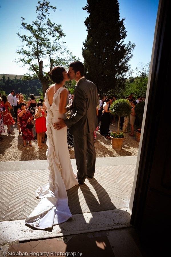 A kiss outside the church at Borgo Di Tragliata.