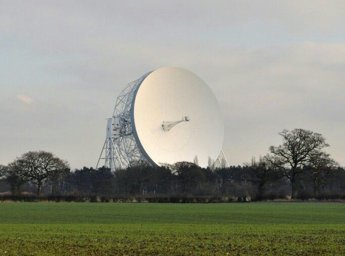 Iconic structure - Jodrell Bank radio telescope towers above the trees