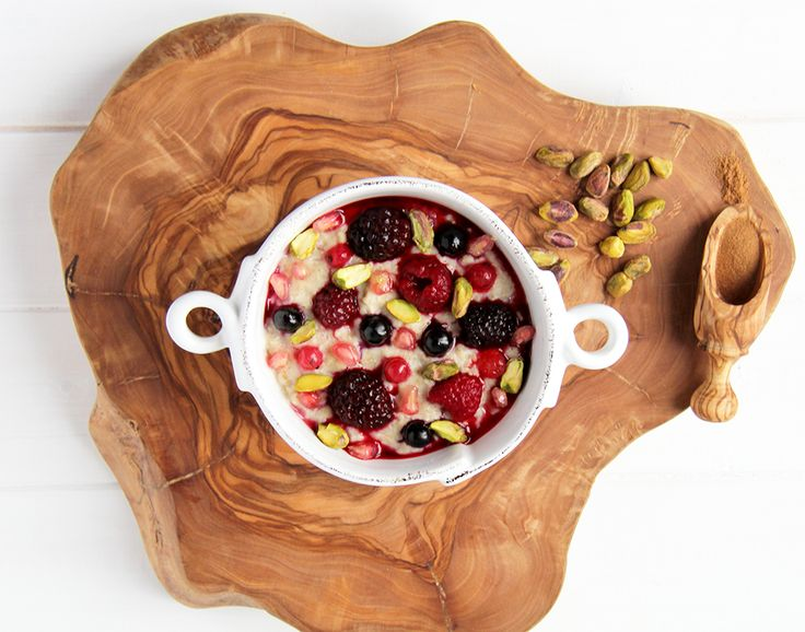 You can't beat this winter breakfast! Scrummy porridge with berries, pistachios, pomegranates and cinnamon. #yummy
