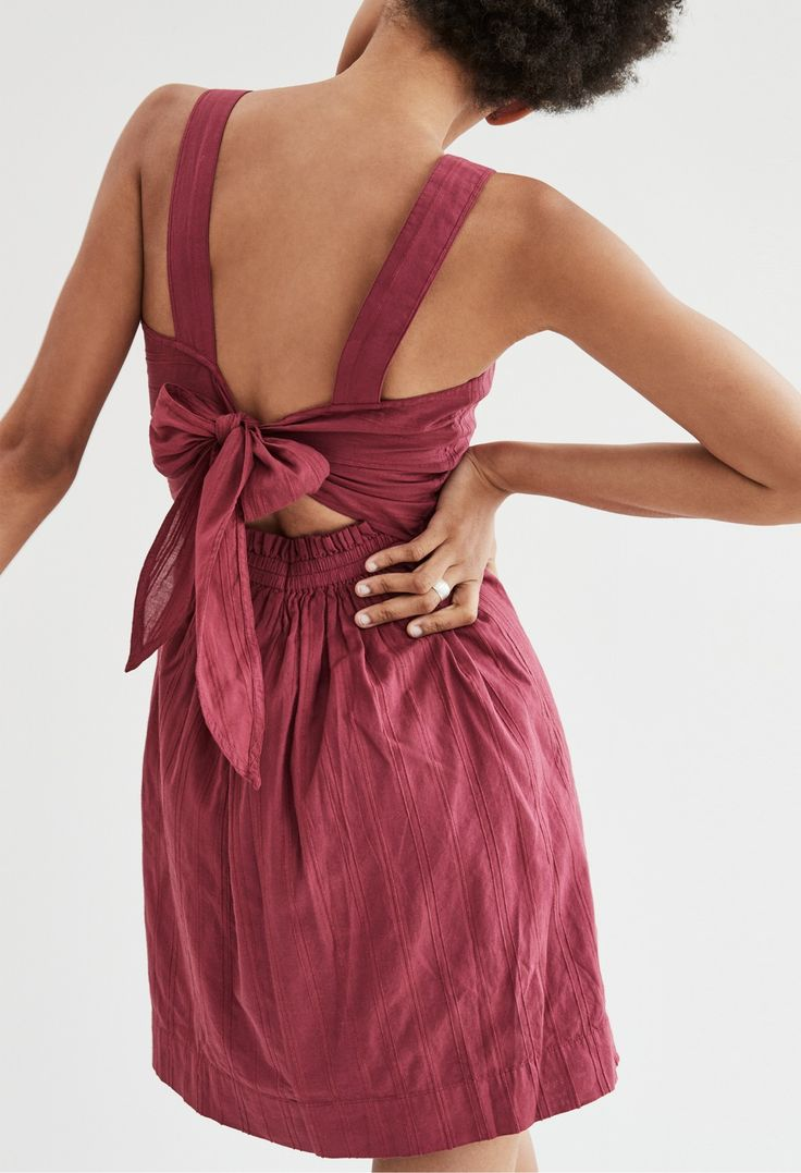 madewell apron bow-back dress worn with the wide band ring.