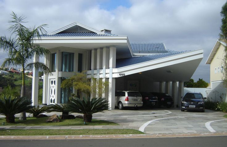 40 fachadas de casas modernas e esculturais maravilhosas for Fotos de casas modernas com telhado aparente