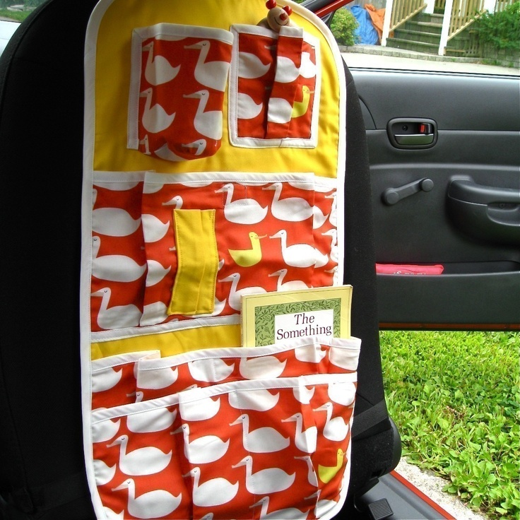 kids car seat organizer / modern baby and toddler pockets holder accessory / rainbow dots (ready to ship). $75.00, via Etsy.