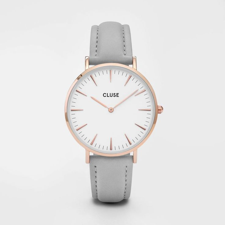 CLUSE La Bohème Rose Gold White/Grey This La Bohème model features an ultrathin case with a 38 mm diameter, crafted with precision for a sophisticated and elegant result. Eggshell white and rose gold are combined with a grey leather strap, detailed with a rose gold clasp. The strap can be easily interchanged, allowing you to personalise your watch. Also available in silver and gold.
