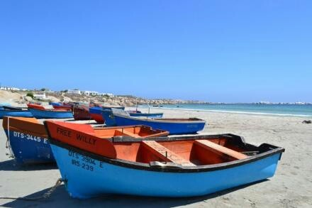 Colorful boats at the seaside; village of Paternoster, South Africa