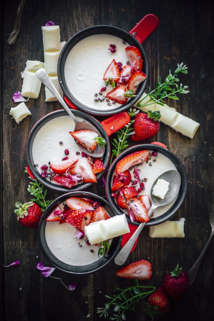 White Chocolate Panna Cotta served with fresh strawberries, dried pomegranate seeds and cocoa nibs