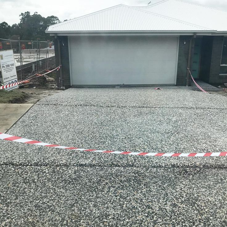 Drive way back patio and air con slabs have finally been done! Cant wait to see them and the bricks acid washed.  #newbuild #driveway #exposedaggregate  #construction #firsthome