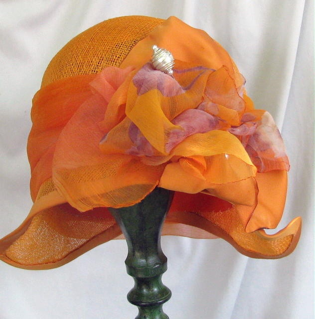 Gail Bartlett creates the beautiful hats.  I love the ones that are in Vintage Cloche Style.   Wish I look good in hats.