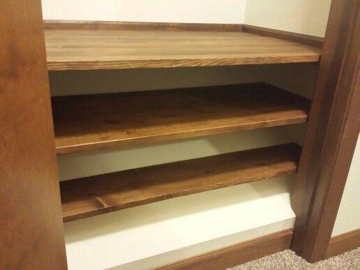 Slanted closet floor due to stairway below? Don't waste the space by blocking it in; add shelves! Storage, storage & more storage :)