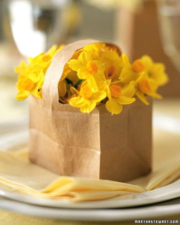 Try a twist on Easter baskets, and make a paper basket bouquet for every place setting. All you need are small brown paper bags, baby-food jars or shot glasses, and your favorite blooms