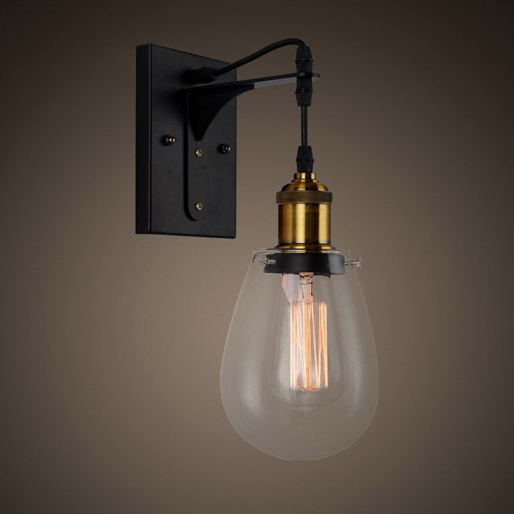 Exquisitely and elegantly detailed, this tear drop shaped wall lamp is a simple design full of style and a modern industrial look for room decor. With a clear glass shade hanged from the black cord, this wall sconce will offer you soft and warm glow when collocated with the suggested Edison bulb. In addition, the black finish blends beautifully with the clear glass shade to add a made industrial era look in your space. You can freely mount it in the living room, dining room, or the hallway…