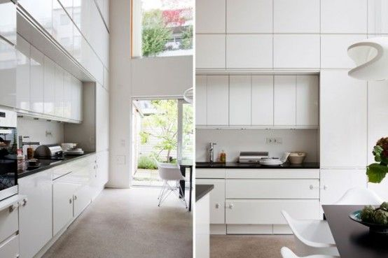 A Cozy Townhouse In Sweden With A Scandinavian Style: White Sleek Design For Kitchen Decoration With Nice Cabinetry Design And Black Cooktop...