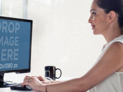 Desktop PC Mockup Generator of a Pretty Lady at Work a5497