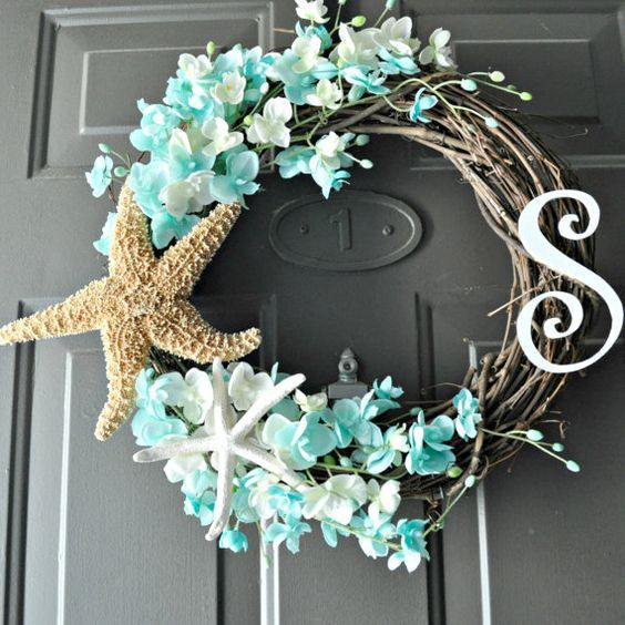 gorgeous starfish and floral wreath.  Perfect for a beach themed party!