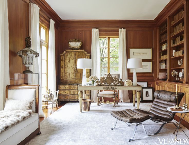 Floor-to-ceiling curtains in a Holly Hunt fabric and a plush rug by Azar Fine Rugs lighten the cypress-clad study of this New Orleans estate. Louis-Philippe daybed, Tara Shaw Antiques; lamps, Regina Andrew. Tour the rest of the home here.   - Veranda.com