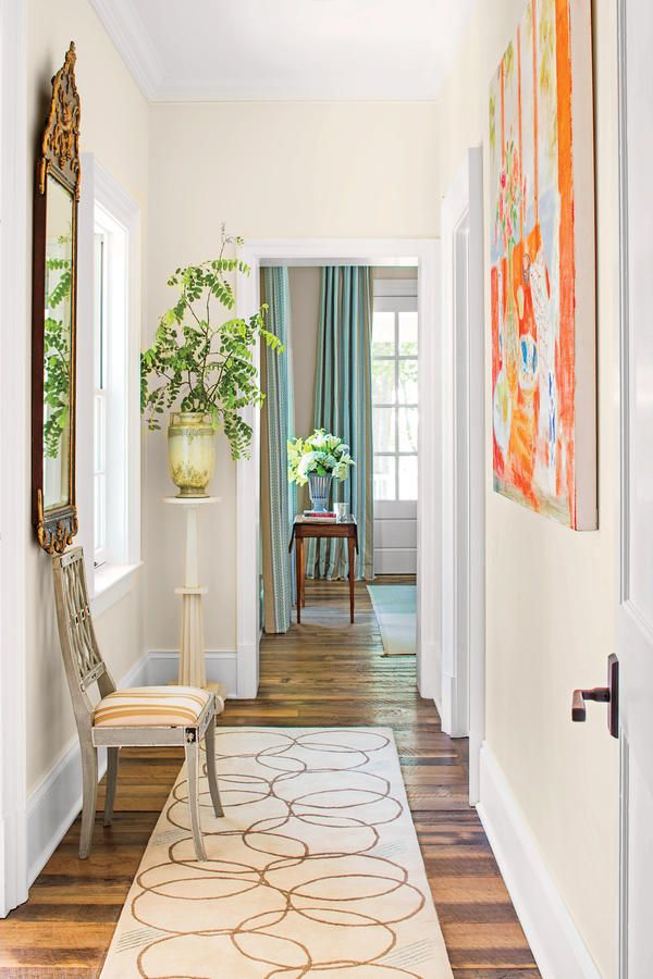 "Hallway - 2015 Charlottesville Idea House Tour - Southernliving. ""It's important not to paint your house with a confusing riot of colors. I like to use a lot of soft, warm beiges to keep rooms coherent while giving them character."" (Shown here: walls, Steamed Milk, and trim, Pure White"