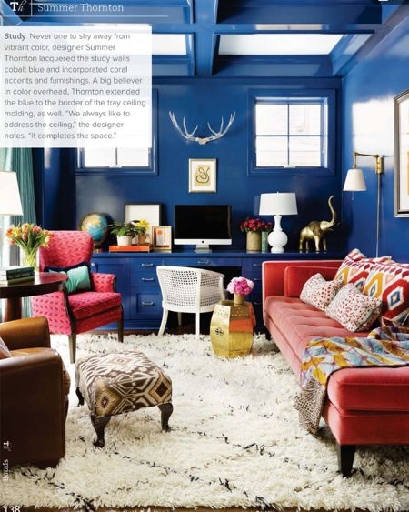 very this dazzling blue living room has all the right design elements for spring