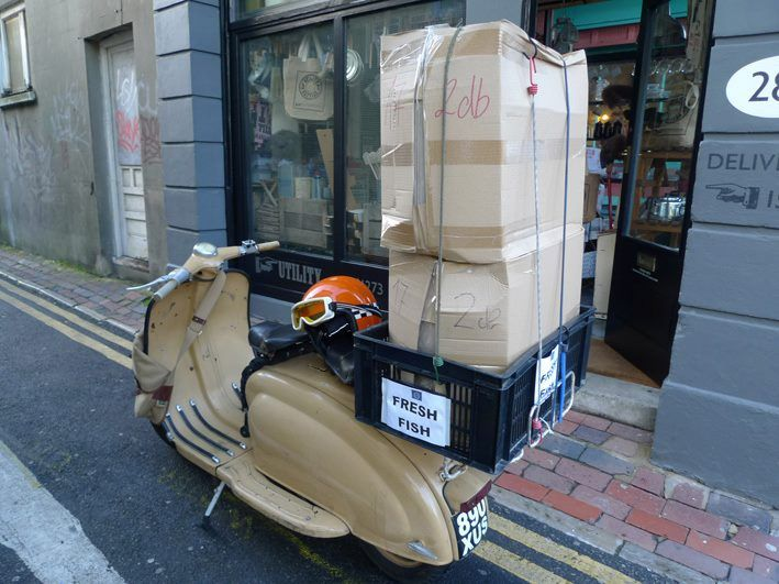 Fresh fish delivery by Vespa.