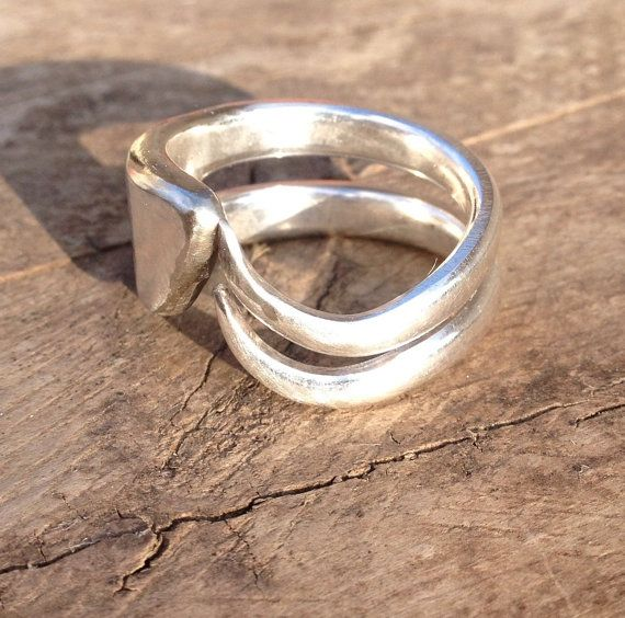 This unique ring was handcrafted from the base of a Silver Plated Fork.  It is a true One of a Kind piece of Jewelry that is sure to make a statement. The ring pictured is a size 9 as sizes vary it may change the shape of the design slightly.  All of our rings are placed in a black jewelry box and wrapped suitable for any occasion.  This ring is ready to Ship