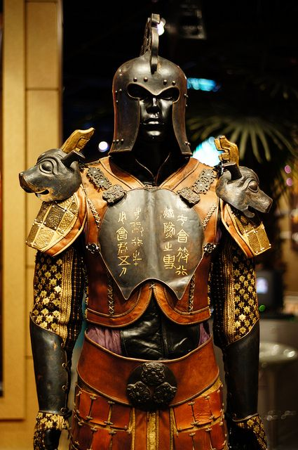 aromansoul:  Chinese armor. Tang dynasty. First is a royal guard, similar to a samurai and the second is a northern foot soldier.  non-westernhistoricalfashion:  Here are more shots of the costumes in the post with the armor. As nextian pointed out, they are indeed from the film The Banquet. You can see the still of Zhang Ziyi in the background.