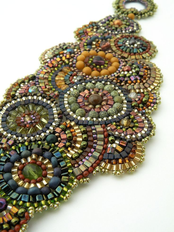Gorgeous mix of beads and brick stitch! Love the circular design of this bracelet