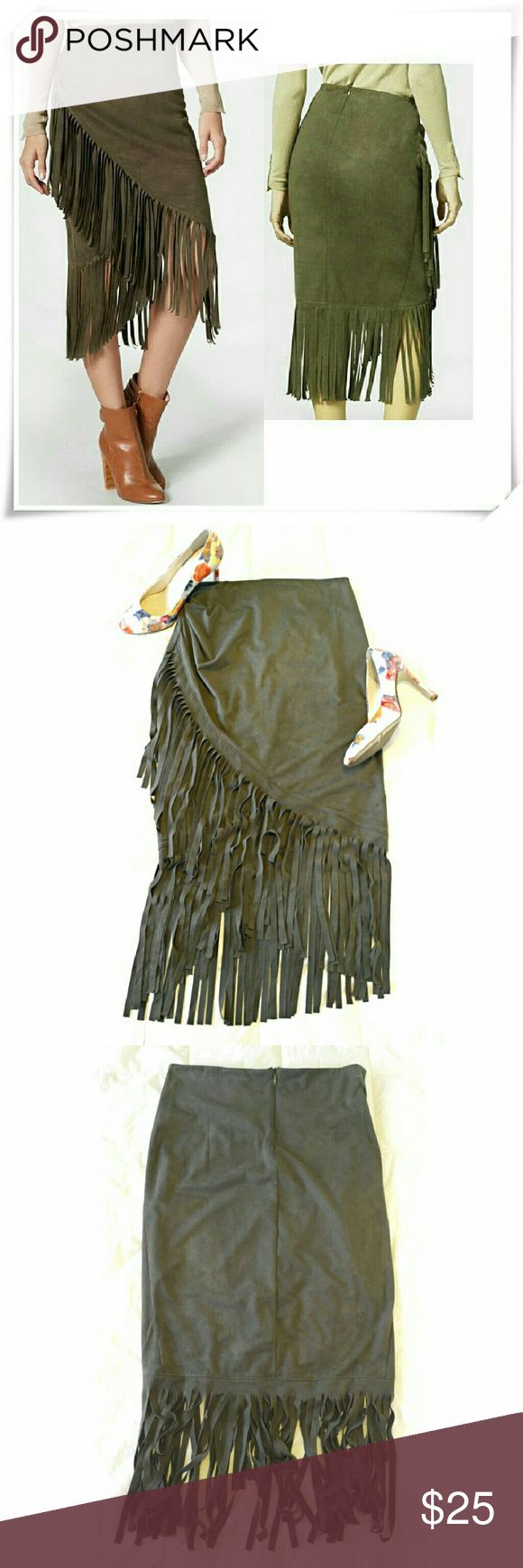 Faux suede fringe skirt Assimetrical faux suede skirt. Measurments will be posted shortly  ?? Ask questions ??  Lined till the shortest hem of the skirt. The color looks different depending on the light. The stock picture looks brown, but the real color is olive green. The skirt is very stretchy, including the waist. Recommended for not very curvy girls. Back zip clouser. JustFab Skirts Asymmetrical