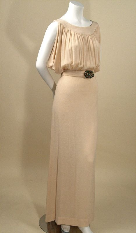 1930s cream silk bias cut evening gown with green jeweled belt.