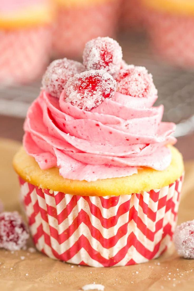 Sparkling Cranberry White Chocolate Cupcakes - Vanilla cupcakes with white chocolate ganache filling and cranberry buttercream frosting.   browneyedbaker.com