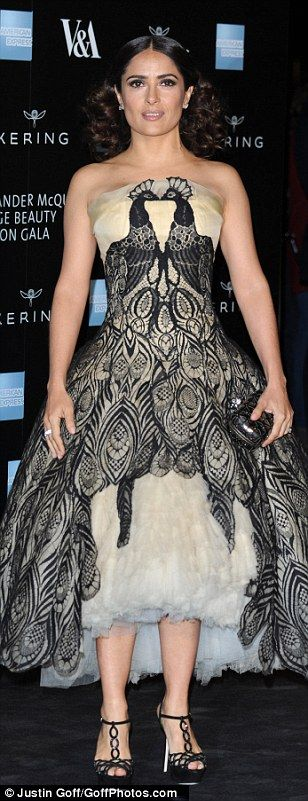 Detail: She added height to the look with black cut-out heels and wore her locks off her f...