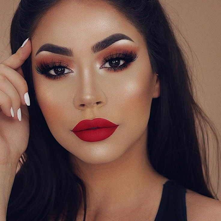 Full Face Makeup On Woman With Olive Skin And Dark Black
