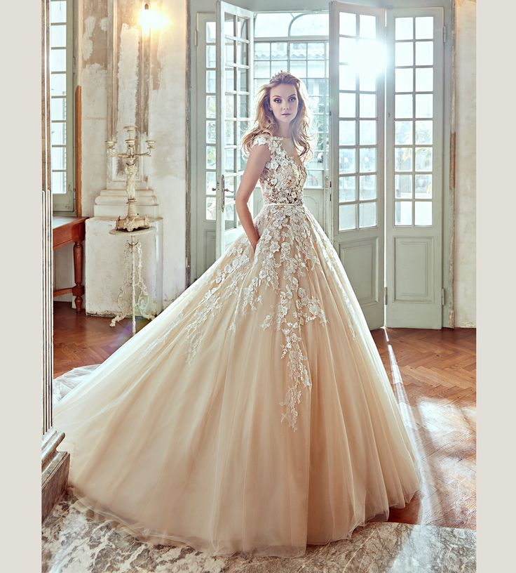 Fashion bride 2017 - Collection NICOLE. NIAB17092. Wedding Dress Nicole. A little too dramatic for me but I love the appliques going down the skirt of the dress...