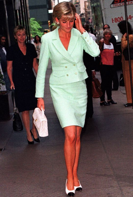 Princess Diana in a mint green skirt suit and a white quilted Chanel bag.