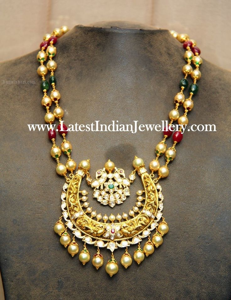 Exclusive fashionable beads neck piece from Hiya Jewellers, Hyderabad. The double stringed pearl, ruby and emerald necklace paired with a stunning mughal inspired bali style heavy antique pendant decorated with kundans and pearls.