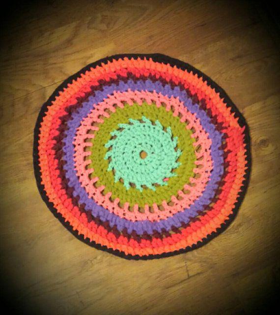 Hand crocheted tshirt yarn rug  https://www.etsy.com/listing/238477141/gorgeous-hand-crocheted-multi-coloured