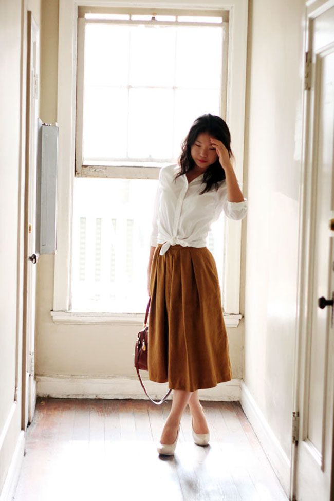 in love w this midi skirt 20 Ways to Style the Classic White Button-Down | The Everygirl