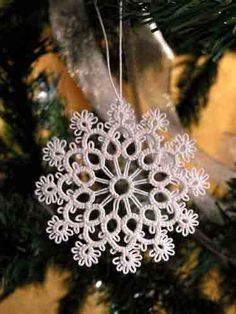 craft lessons: lace fan! tatting tutorial - crafts ideas - crafts for kids [beautiful examples of tatting and 'how to' using a 'needle and thread', ie - needle tatting. I've yet to compare needle tatting with (what I know of) shuttle tatting, how the patterns can be/can't be transferred from one way to the other - NB]