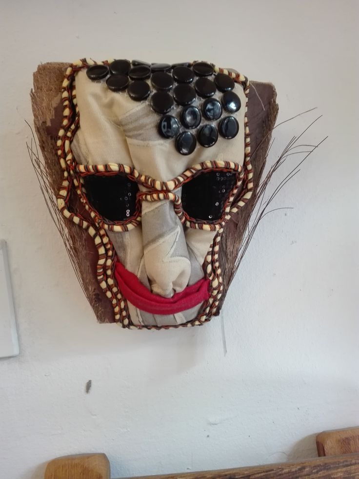 mounted on a palm leaf funky African mask, textile and ceramic madeincapetown