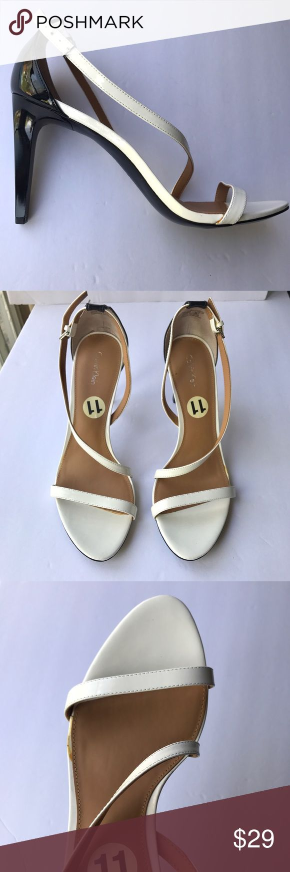 {calvin klein} black and white strappy heels Gorgeous two tone heels with lovely straps on upper. Stylish and like new! Adjustable at the ankle. Can be dressed up or down for an elegant look. Calvin Klein Shoes Heels