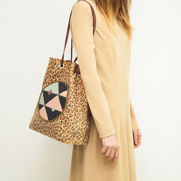 Leopard print tote bag with a geometric design on the front in soft fabric - if you like this you will like what we have at our website www.themanysides.com