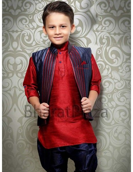 Radiant red color raw silk short kurta with navy blue color stripes design nehru jacket and matching breeches is adding glamour to the look.