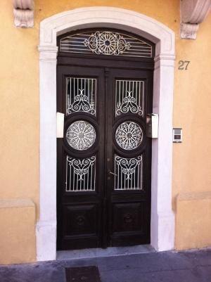 Beautiful Wooden Door | Buccari. Nice metalwork to compliment the beautiful wooden doors. by echkbet